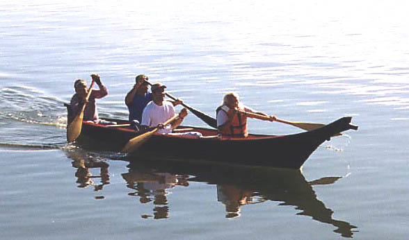 A photo of a taped-seam plywood replica Coquille dugout canoe